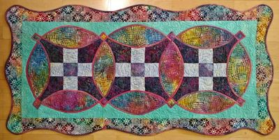 Amanda's 3 block quilt with scalloped edges.